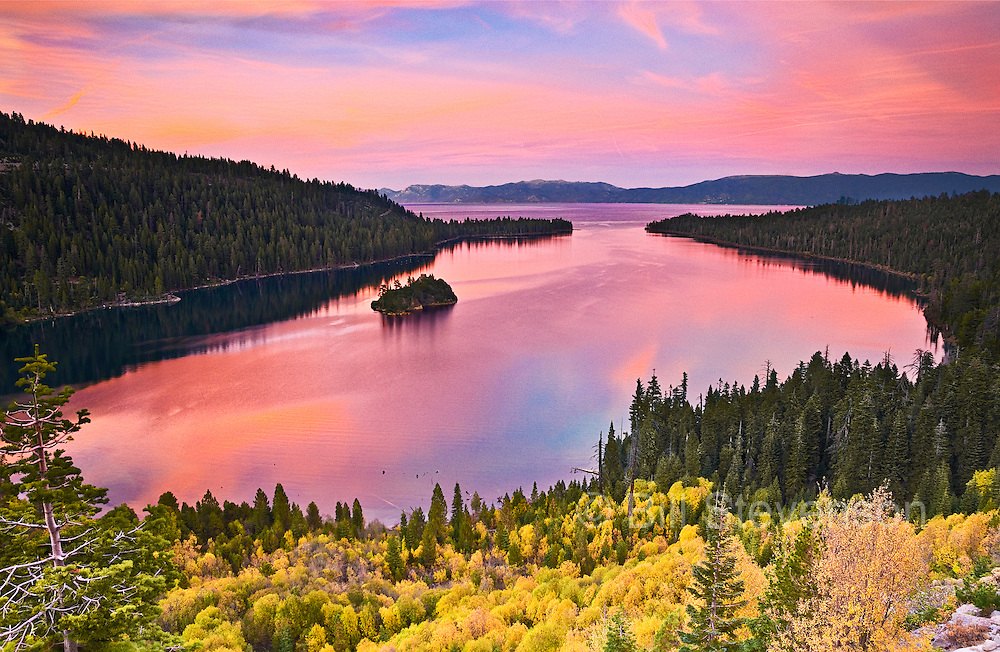 A landscape photo of sunrise and autumn leaves  at Emerald Bay, Lake Tahoe. This is an unusual combination of two fleeting  natural phenomena, a great sunrise and yellow willow bushes. In some years the sunset would be great but the willows dull. In other years the opposite would happen. In 2010 everything was just right.