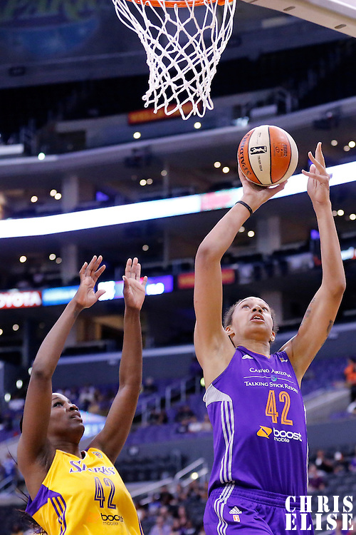 18 May 2014: Phoenix Mercury center Brittney Griner (42) goes for the layup past Los Angeles Sparks center Jantel Lavender (42) during the Phoenix Mercury 74-69 victory over the Los Angeles Sparks, at the Staples Center, Los Angeles, California, USA.