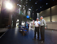Dick Blum (from left) of Coralville talks with Roy Justis of Iowa City on the stage during the open house for the Coralville Center for the Performing Arts in Coralville on Saturday, August 27, 2011.