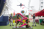 UNITED KINGDOM, London: 10 April 2018. Acrobats, jugglers and contortionists from Circus Abyssinia perform in front of the London Eye as they launch their headline run at the Underbelly Festival Southbank. The Ethiopian circus act Circus Abyssinia: Ethiopian Dream's will help celebrate 250 years of circus and 10 years of the Underbelly festival. Rick Findler / Story Picture Agency