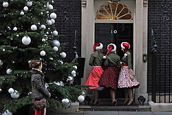 © Licensed to London News Pictures. 12/12/2011, London, UK.Children's entertainers on the doorstep at 10 Downing Street today, Monday 12th December 2011. The Primeminister is hosting a christmas party for children today. Photo credit : Stephen Simpson/LNP