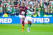 Clevid Dikamona (#28) of Heart of Midlothian shields the ball from Odsonne Edouard(#22) of Celtic FC during the Betfred League Cup semi-final match between Heart of Midlothian FC and Celtic FC at the BT Murrayfield Stadium, Edinburgh, Scotland on 28 October 2018.