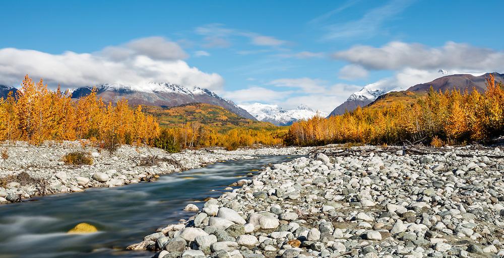 Long exposure of Granite Creek and Talkeetna Mountains along the Matanuska Valley in Southcentral Alaska. Autumn. Morning.