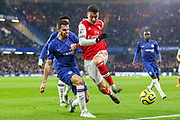 Chelsea defender César Azpilicueta (28) challenges Arsenal forward Gabriel Martinelli (35) during the Premier League match between Chelsea and Arsenal at Stamford Bridge, London, England on 21 January 2020.
