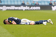 Millwall midfielder Ben Marshall (44) lies on the floor injured, during the EFL Sky Bet Championship match between Millwall and West Bromwich Albion at The Den, London, England on 6 April 2019.