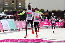 Mo Farah crosses the finish line to win the men's race during the Vitality Big Half in London.