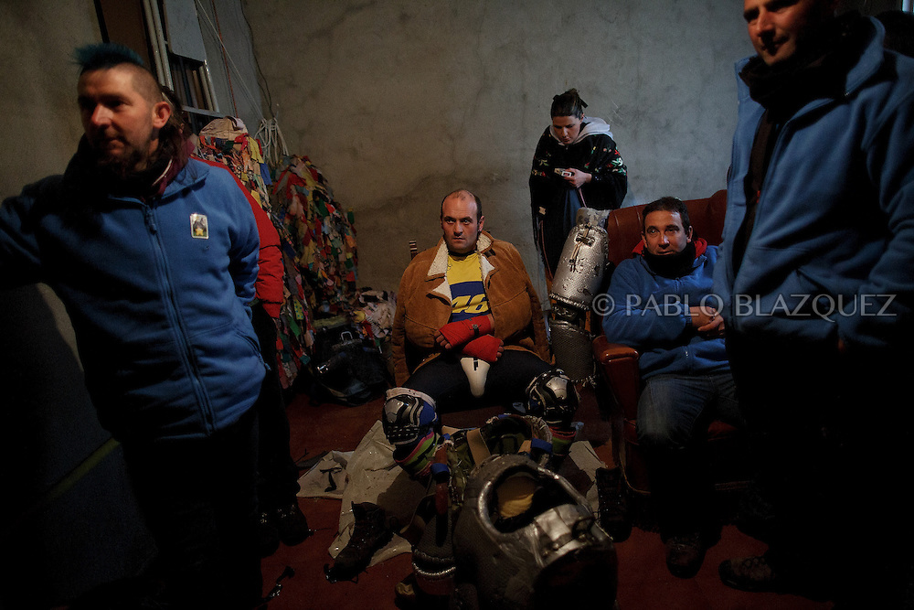 Raul Beites 34, waits to be dressed as Jarramplas and make his way through the streets beating his drum during the Jarramplas Festival on January 20, 2015 in Piornal, Spain. The centuries old Jarramplas festival takes place annually every January 19-20 on Saint Sebastian Day. Even though the exact origins of the festival are not known, various theories exist including the mythological punishment of Caco by Hercules, a relation to ceremonies celebrated by the American Indians that were seen by the first conquerors, to a cattle thief ridiculed and expelled by his village neighbours. It is generally believed to symbolize the expulsion of everything bad. This year the people who represented Jarramplas were Angel Cerro Fernandez on 19 January and Carlos Calle Rodríguez 47 and Raúl Beites Sánchez 34 on 20 January.