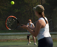 Baileigh Stillings of White Mountain returns a serve by Gilford's Emily Curtis during girls varsity tennis on Wednesday afternoon.  (Karen Bobotas/for the Laconia Daily Sun)
