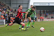 George Francomb of AFC Wimbledon and Jamie Devitt of Morecambe FC tussle during the Sky Bet League 2 match between Morecambe and AFC Wimbledon at the Globe Arena, Morecambe, England on 12 March 2016. Photo by Stuart Butcher.