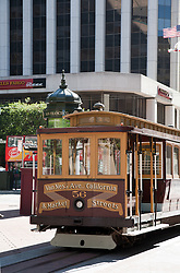 San Francisco, CA: Cable car running along Market Street in San Francisco, between California Street and VanNess Avenue.