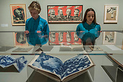 Books by Rodchenko and Raise high the banner of Marx Engel, Lenin and Stalin, 1933 by Gustave Klutsis - Pupils from Thomas Tallis School in Kidbrooke who are doing Russian studies, visit the exhibition - Tate Modern's new exhibition Red Star Over Russia on the 100th anniversary of the October Revolution. The exhibition offers a visual history of the Soviet Union, revealing how seismic political events inspired a wave of innovation in art and graphic design. Featuring over 250 posters, paintings and photographs, many on public display for the first time, the exhibition will provide a chance to understand how life and art were transformed during a defining period in modern world history.