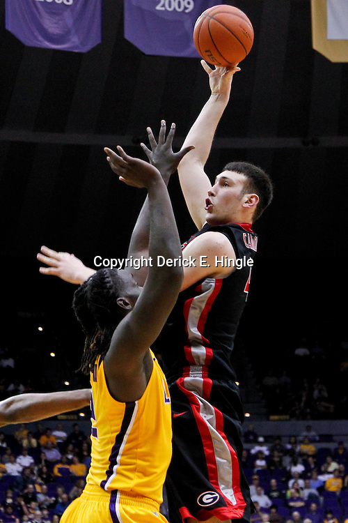 February 22, 2012; Baton Rouge, LA; Georgia Bulldogs center John Cannon (41) shoots over LSU Tigers forward Johnny O'Bryant (2) during the second half of a game at the Pete Maravich Assembly Center. LSU defeated Georgia 61-53. Mandatory Credit: Derick E. Hingle-US PRESSWIRE