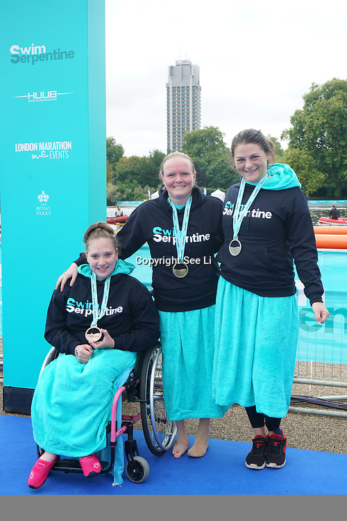 London, England, UK. Charlie Hyde, Frances Bateman and Susie Rogers winner of the Swim Serpentine the Elite women's para race at Serpentine lake.