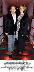 SIMON & SANTA SEBAG-MONTEFIORE, she is the sister of Tara Palmer-Tomkinson,  at a party in London on 28th October 2003.PNW 315
