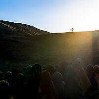 Kamil Tatarkovic entertains the local onlookers at dusk, during a 9-day traverse of Ethiopia's Simien Mountains.
