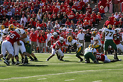 16 October 2010:  Mike Sigers looks for a hole but fines Josh Howe and Kelvyn Hemphill during a game where the North Dakota State Bison lost to the Illinois State Redbirds 34-24, meeting at Hancock Stadium on the campus of Illinois State University in Normal Illinois.
