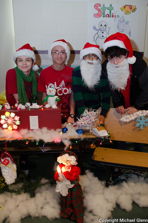 """19 Dec. 2013 Manahawkin USA // Schyler, James, Arnold and Anthony run the Math Family Feud game at the """"Winter Wonderland"""" Math exhibit"""