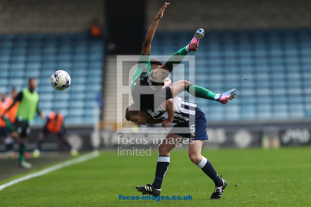 Ivan Toney of Scunthorpe United performs a jumping tackle on Tony Craig of Millwall during the Sky Bet League 1 match at The Den, London<br /> Picture by Toyin Oshodi/Focus Images Ltd 07984788195<br /> 01/04/2017