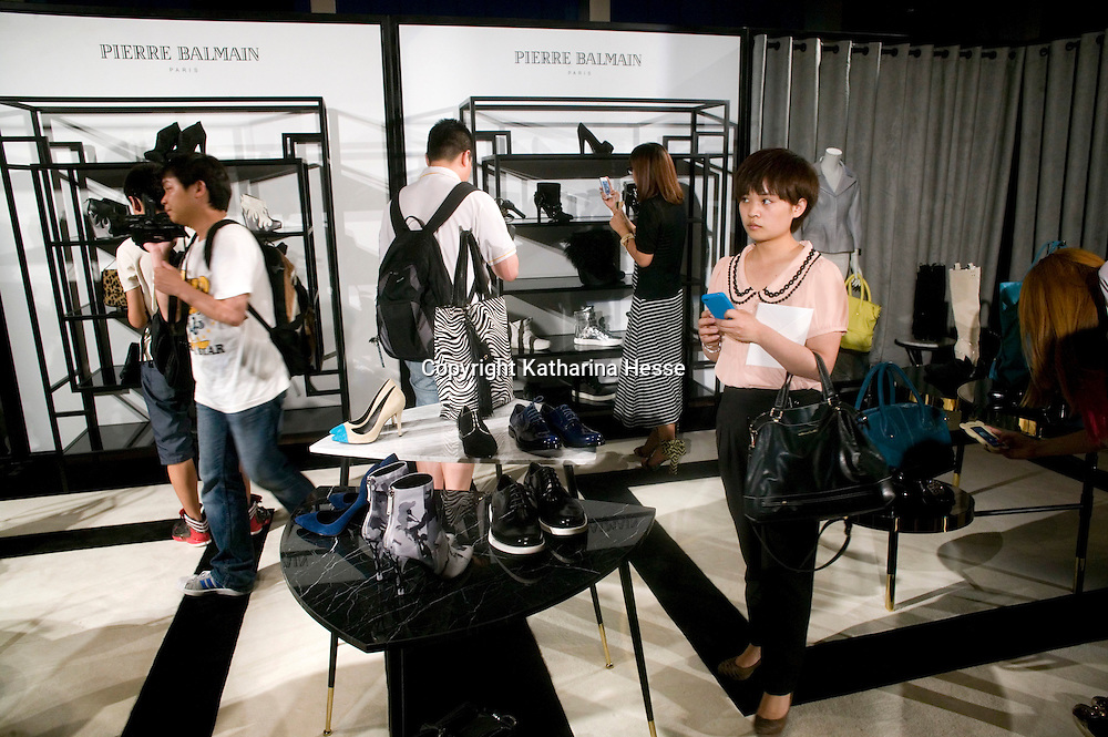 BEIJING, MAY-22 :   guests  look the the accessories which are part of the Balmain spring/summer 2012 collection.