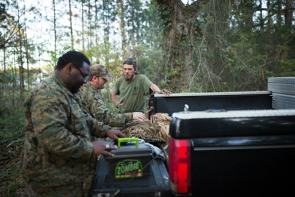 Members of Georgia Security Force III% militia: Jacob Sims (SK Jack and commanding officer of South Carolina Security Force III%), right, Scorpion (did not want to give full name), center, and Phillip King (Cowboy) talk after running a training course built for the GSF III% on private property near Jackson, Ga. This photograph was taken on Saturday, April 1, 2017. Photo by Kevin D. Liles for BuzzFeed<br /> <br /> <br /> Shot during a FTX (field training exercises) weekend for Georgia Security Force III% militia, as well as some members for the South Carolina Security Force III%. GSF III% is part of the umbrella group, III% Security Force, which includes groups from several states. Chris Hill (Blood Agent), commanding officer of GSF III%, is the founder of the Security Force movement. According to him, GSF III% membership fluctuates between 30-50 members and growing by about one member per day.  GSF III%, as do the other groups, train one weekend per month.