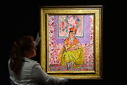 "© Licensed to London News Pictures. 15/06/2017. London, UK. A staff member hangs ""La Martiniquaise"", 1931, by Raoul Dufy (estimate GBP500-700k). Preview of Impressionist and Modern art sale, which will take place at Sotheby's New Bond Street on 21 June.  Photo credit : Stephen Chung/LNP"
