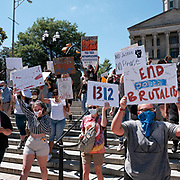 Protesters hold signs while they march into Legislative Plaza in Nashville, TN on May 30th 2020