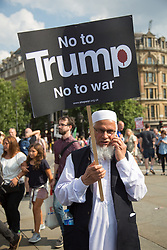 @Licensed to London News Pictures 13/07/2018. London, UK. Demonstrators march through the streets of Central London arriving at Trafalgar Square in protest to the US President Donald Trump' visit to the UK.Photo credit: Manu Palomeque/LNP