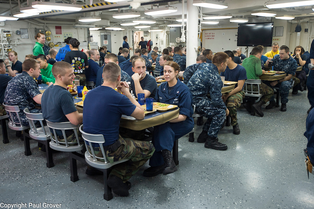 USS John C Stennis CVN-74 Aircraft Carrier.Pic Shows Ships crew sitting down to food