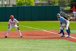 NORMAL, IL - May 01: Derek Parola take a lead from 1st with Dane Tofteland covering and Wayne Harris as Ump during a college baseball game between the ISU Redbirds and the Indiana State Sycamores on May 01 2019 at Duffy Bass Field in Normal, IL. (Photo by Alan Look)