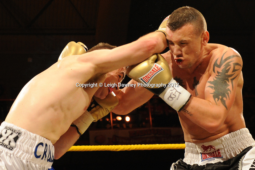 JJ McDonagh (black/white shorts) defeats Darren Cruise in Quarter Final three at Prizefighter Middleweights, Kings Hall, Belfast, Northern Ireland on 5th May 2012. Promoted by Prizefighter/Matchroom Sport. © Leigh Dawney Photography 2012.