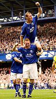 Photo. Jed Wee.<br /> Everton v Leeds United, FA Barclaycard Premiership, Goodison Park, Liverpool. 28/09/2003.<br /> Everton's Duncan Ferguson jumps on the shoulders of hattrick hero Steve Watson.