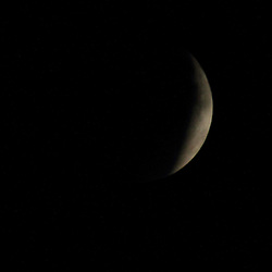 2015 September 27: On a partially cloudy night with the moon in full phase and in a Super Moon cycle with the moon just a little closer to the earth, an eclipse occurred that created a blood red moon.  This is a rare occurrence and will next be seen in 2033.