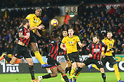 Wolverhampton Wanderers defender Willy Boly (15) rises highest but cannot connect during the Premier League match between Wolverhampton Wanderers and Bournemouth at Molineux, Wolverhampton, England on 15 December 2018.