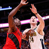 09 April 2018: Portland Trail Blazers forward Al-Farouq Aminu (8) vies for the rebound with Denver Nuggets center Mason Plumlee (24) during the Denver Nuggets 88-82 victory over the Portland Trail Blazers, at the Pepsi Center, Denver, Colorado, USA.