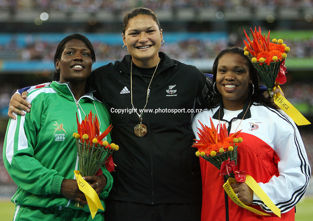 New Zealand shot put athlete Valerie Vili (NZL) (centre) with her gold medal along with Cleopatra Borel-Brown (TRI) (L) and Vivian Chukwuemeka (NGR) (R) on Day 8 of the XVIII Commonwealth Games at the MCG, Melbourne, Australia on Thursday 23 March, 2006. Photo: Hannah Johnston/PHOTOSPORT