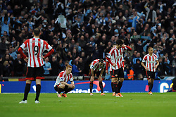 Sunderland City players cut dejected figures after losing to Manchester City in the Capital One Cup Final - Photo mandatory by-line: Dougie Allward/JMP - Tel: Mobile: 07966 386802 02/03/2014 - SPORT - FOOTBALL - London - Wembley Stadium - Manchester City v Sunderland - Capital One Cup Final