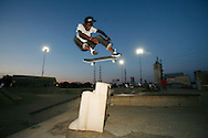 Tyrone Porter flies over a chair. ..During the Santa Cruz Skateboards and Creature Skateboards team tour which made a stop at Louisville Extreme Park to film scenes for a new promotional video.