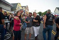 Kayleigh Ash, Manny Nasser, Carlos Lorber and Katie Chase take in the street party during Biketemberfest on Saturday night.  (Karen Bobotas/for the Laconia Daily Sun)