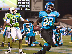 November 19, 2009; San Francisco, CA, USA;  Florida Tuskers defensive back Michael Pittman (22) rushes for a 1 yard touchdown past California Redwoods defensive back Robert Herbert (31) during the second quarter at AT&T Park. Florida defeated California 34-27.