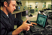 "UC Berkeley graduate student Eric Paulos calibrates his Personal Roving Presence (PRoP), which he describes as ""a simple, inexpensive, Internet-controlled, untethered tele-robot that strives to provide the sensation of tele-embodiment in a remote real space."" Berkeley, CA . From the book Robo sapiens: Evolution of a New Species, page 168."