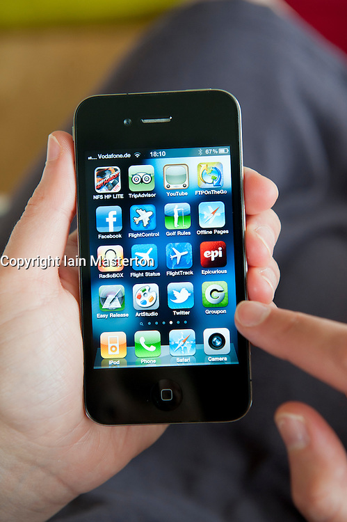 close-up of person using iPhone 4G smart phone