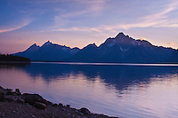 Sunset over the Teton Range and Jackson Lake.  Grand Teton National Park.  Wyoming, USA.