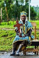 Orthodox Christian man holding a cross, Gojjam, Amhara region, Ethiopia.