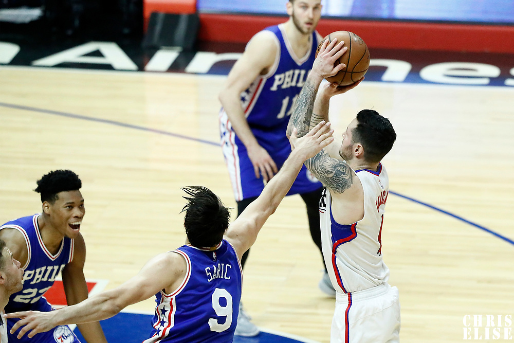 11 March 2017: LA Clippers guard J.J. Redick (4) takes a jump shot over Philadelphia 76ers forward Dario Saric (9) during the LA Clippers 112-100 victory over the Philadelphia Sixers, at the Staples Center, Los Angeles, California, USA.