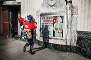 Los Angeles, April 9 2012- A man dressed up as a transformer and leaving his job for the tourists of Hollywood Boulevard walks in front of Marilyn Monroe and the Hollywood museum.