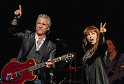 "Neil ""Spyder"" Giraldo and Pat Benatar perform at ACL Live at the Moody Theater, Austin Texas, April 13, 2013. Pat Benatar (born Patricia Mae Andrzejewski on January 10, 1953) is a four-time Grammy Award-winning American singer best known for her mezzo-soprano vocal range on hit songs such as ""Love Is a Battlefield"", ""Hit Me with Your Best Shot"", and ""Heartbreaker""."