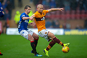 Curtis Main (#9) of Motherwell FC holds off Jon Flanagan (#15) of Rangers FC during the Ladbrokes Scottish Premiership match between Motherwell and Rangers at Fir Park, Motherwell, Scotland on 26 August 2018.