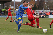 Dannie Bulman of AFC Wimbledon and Bennett of York City FC challenge for the ball during the Sky Bet League 2 match between AFC Wimbledon and York City at the Cherry Red Records Stadium, Kingston, England on 19 March 2016. Photo by Stuart Butcher.