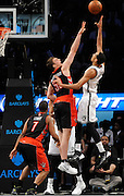 Brooklyn Nets Brooklyn Nets' Shaun Livingston (14) shoots over Toronto Raptors' Tyler Hansbrough (50) and Kyle Lowry (7) during an NBA basketball game on Monday, March 10, 2014 at Barclays Center in New York. The Nets won 101-97. (AP Photo/Kathy Kmonicek)