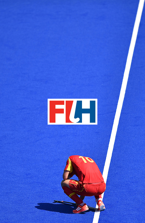 Spain's David Alegre reacts after loosing the men's quarterfinal field hockey Spain vs Argentina match of the Rio 2016 Olympics Games at the Olympic Hockey Centre in Rio de Janeiro on August 14, 2016. / AFP / MANAN VATSYAYANA        (Photo credit should read MANAN VATSYAYANA/AFP/Getty Images)